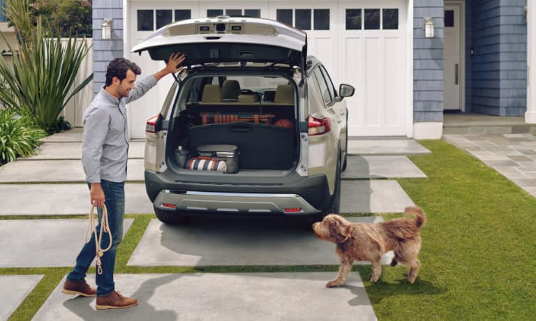 Man loading the trunk on 2021 Nissan Rogue