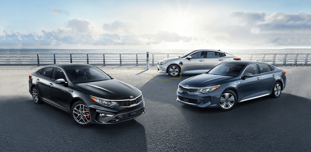 2020 Kia Optima trim levels parked near one another on pier