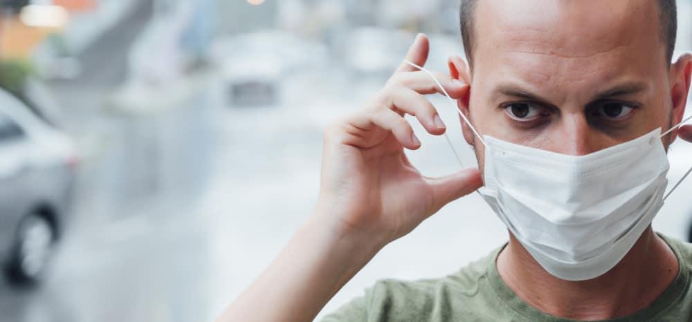 Man putting on a mask