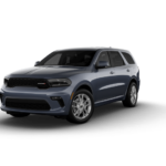 A blue-gray 2021 Dodge Durango SUV against a white background.