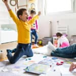 Kid excited to play board game with family
