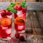 red iced tea with berries, mint, and fruit