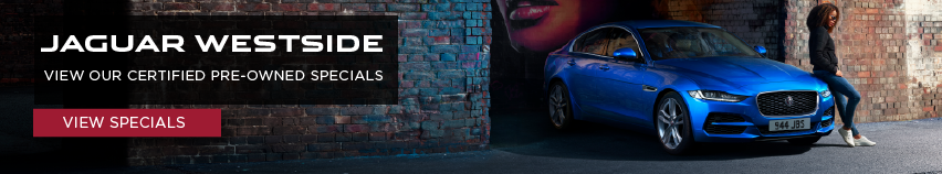 2020 Blue Jaguar XE in alleyway with woman leaning on vehicle. Jaguar Westside. View our CPO Specials. Click to view specials.