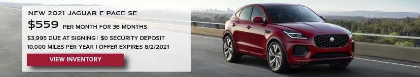 NEW 2021 JAGUAR E-PACE SE. $559 PER MONTH. 36 MONTH LEASE TERM. $3,995 CASH DUE AT SIGNING. $0 SECURITY DEPOSIT. 10,000 MILES PER YEAR. EXCLUDES RETAILER FEES, TAXES, TITLE AND REGISTRATION FEES, PROCESSING FEE AND ANY EMISSION TESTING CHARGE. OFFER ENDS 8/2/2021. VIEW INVENTORY. RED JAGUAR E-PACE DRIVING THROUGH CITY.